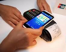 An NFC reader taking an NFC payment from a Samsung phone