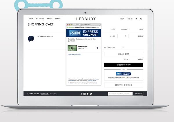A laptop showing AmEx reveals online checkout service
