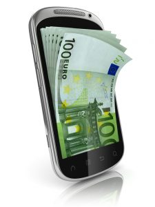 A mobile phone with money on it
